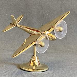 Mirror Polished Brass Model of a WWII Mosquito Plane