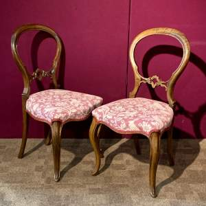 Pair of Victorian Walnut Balloon Back Chairs