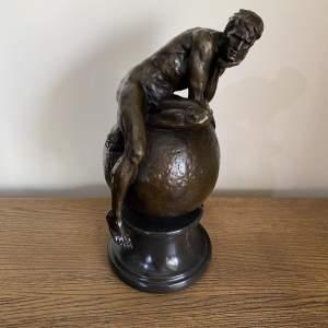 Bronze Figure of a Man on Globe