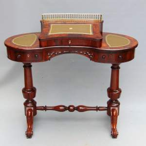 A Good Quality Rosewood Kidney shaped Desk