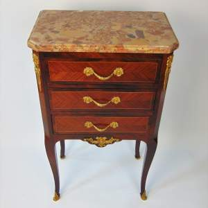 A Petite French Chest of Drawers