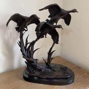 Flock of Bronze Geese Taking Flight Presented on a Marble Base