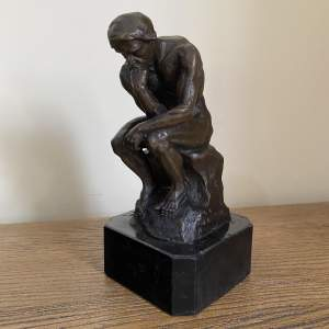Bronze Thinking Man Seated on a Rock Presented on a Marble Base