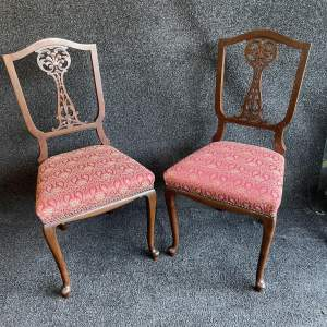 A Pair Of Edwardian Mahogany Saloon Chairs