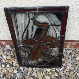 Stained Glass Panel of a Saxophone and Piano