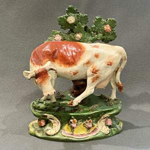 Scarce Staffordshire Pottery Cow Figure with Snake