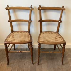 Pair of Arts and Crafts Rattan Chairs