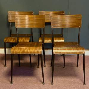 Set of Four Mid 20th Century Wood Laminated Stacking Chairs