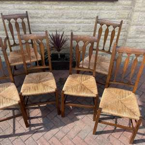 A Set of Six early 20th Century Arts and Crafts style Oak Dining Chairs