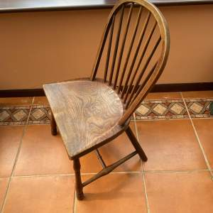 A 19th Century Elm Country Windsor Chair with Bowed Back