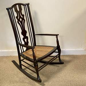 Unusual Low Mahogany Rocking Chair Retailed by Liberty and Co