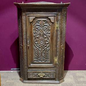 18th Century Carved Oak Corner Cupboard